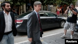 European Commission Director Matthias Morse, center, arrives at finance ministry, Athens, July 2, 2013.
