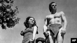 A file photo shows Johnny Weissmuller, right, as Tarzan, Maureen O'Sullivan as Jane, and Cheetah the chimpanzee, in a scene from the 1932 movie Tarzan the Ape Man.