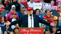 FILE - President-elect Donald Trump speaks during a rally at the Ladd–Peebles Stadium in Mobile, Ala., Dec. 17, 2016. Trump has ruled out selling off his vast global business interests but has said he'll announce a plan next month to address business conflicts.