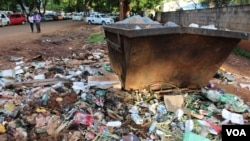 "In Mbare township, the ""epicenter"" of the current typhoid outbreak, sewer water flows and refuse has gone for days without being collected in Harare, Zimbabwe, Jan. 5, 2017. (Photo: S.Mhofu/VOA)"