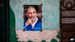 FILE - A poster of Cuban Revolution leader Fidel Castro hangs on a wall in Havana, Cuba, Aug. 13, 2016.