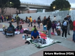 While around 50 asylum seekers entered the El Chaparral port of entry, waiting to be attended, 150 others spent the night outside the gate in Tijuana, Mexico.