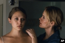 "Elizabeth Olsen (left) and Sarah Paulson, as the sister who takes her in, in ""Martha Marcy May Marlene."""
