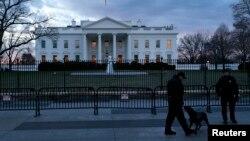 FILE - Secret Service Uniformed Division officers patrol in front of the White House, Washington, D.C., Jan. 20, 2015.