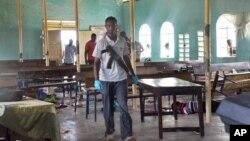 An armed Kenyan policeman walks inside the African Inland Church in Garissa, July 1, 2012.