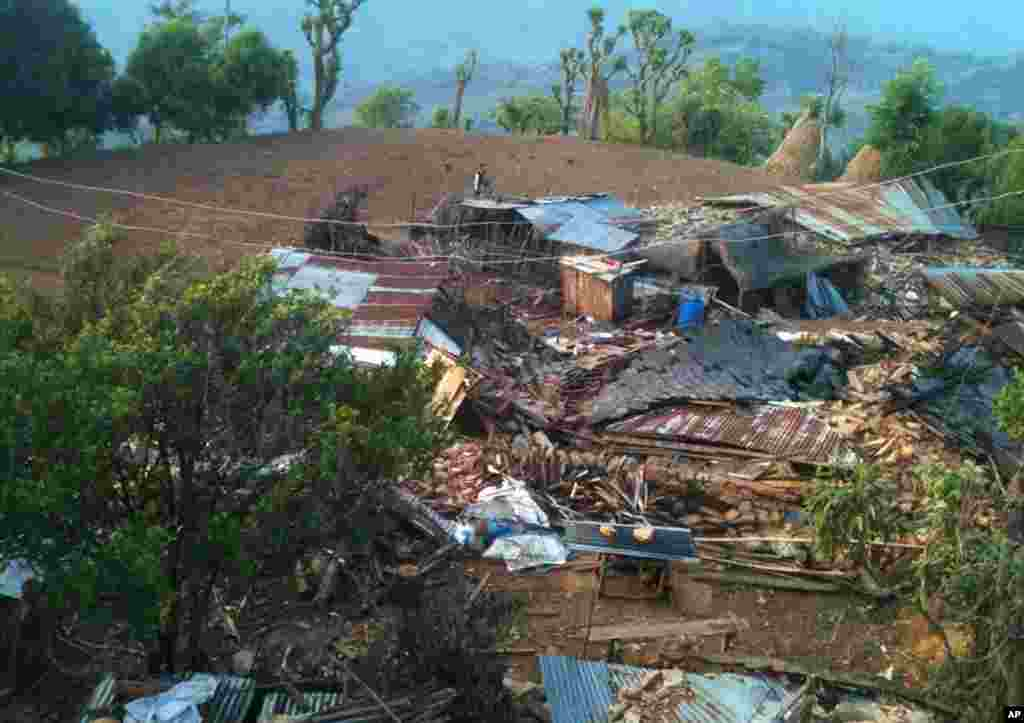 In this photo provided by World Vision, houses lie destroyed by Saturday's earthquake at Paslang village in Gorkha municipality, Nepal on April 27, 2015.