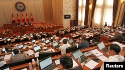 Parliament members attend a session in Bishkek, June 20, 2013.