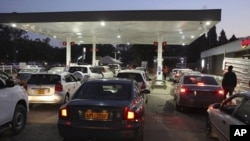 FILE: Motorists wait to fill up their tanks at a fuel station in Harare, Tuesday, Oct, 9, 2018.