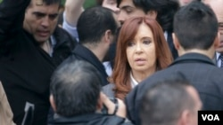 FILE - Former Argentine President Cristina Fernandez de Kirchner leaves court in Buenos Aires, April 13, 2016, after refusing to testify in a state fraud probe. On Thursday, Argentine police searched three of her properties seeking documents.
