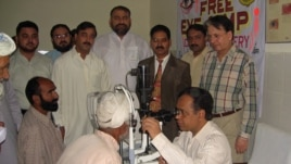 Dr. Ghulam Hussain Asif examines patients during a free clinic.