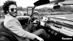 "Bruce Springsteen is shown driving his 1957 Chevrolet Bel Air Convertible in this undated photo, referenced in his iconic song ""Born to Run."" The car is up for auction and is expected to fetch several hundred thousand dollars, photo provided Dec. 15, 2016. (Courtesy Eric Meola/Handout)"