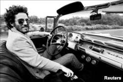 "Bruce Springsteen is shown driving his 1957 Chevrolet Bel Air Convertible in this undated photo, referenced in his iconic song ""Born to Run"" which is up for auction and is expected to fetch several hundred thousand dollars, provided Dec. 15, 2016. (Courte"
