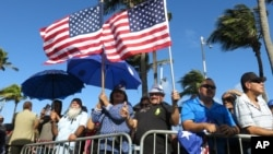 Pro-statehood supporters await the arrival of Puerto Rico's new governor at the seaside Capitol in San Juan, Puerto Rico, Jan. 2, 2017.