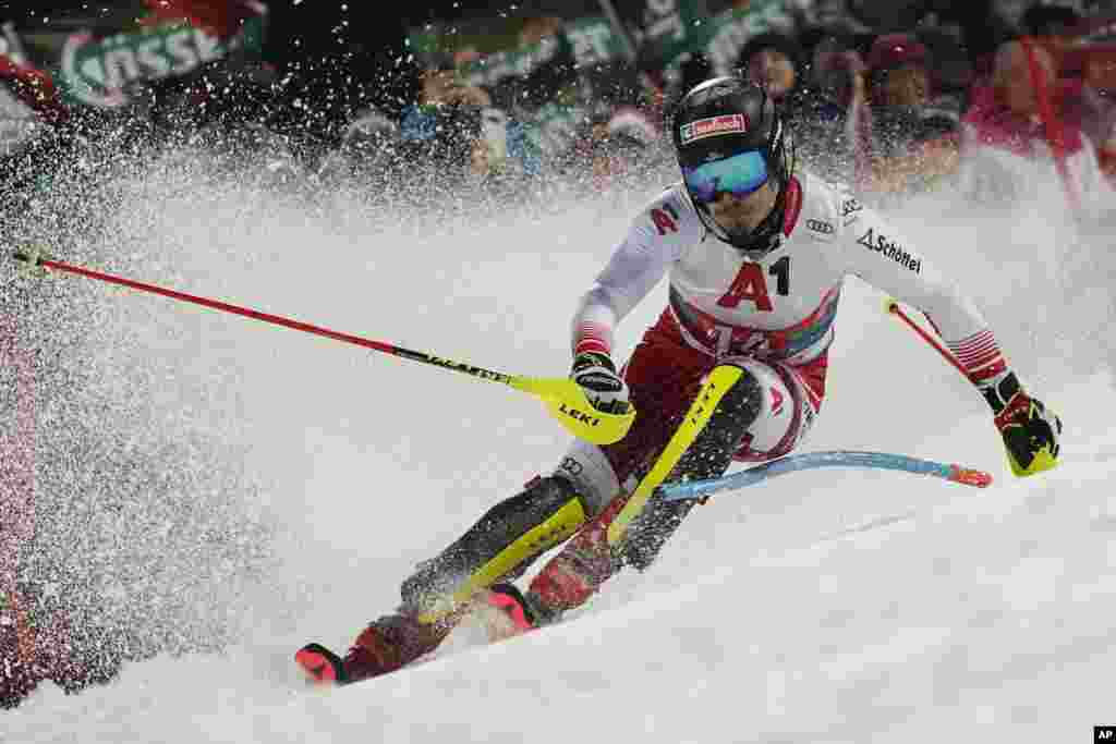 Austria's Manuel Feller speeds down the course during an Alpine ski, men's World Cup slalom, in Schladming, Austria.