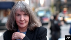 FILE - Sue Grafton is pictured in New York, Oct. 15, 2002. The mystery writer has died in Santa Barbara, Calif., at age 77.