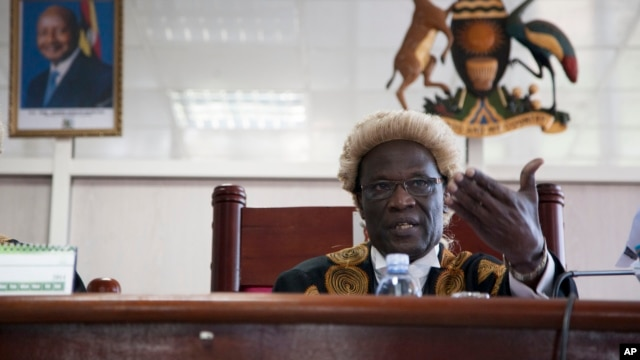 Judge Stephen Kavuma reads the verdict at Uganda's Constitutional court, invalidating an anti-gay bill signed into law earlier this year, saying it was illegally passed and is therefore unconstitutional, Aug.1, 2014.