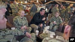 Britain's Prime Minister David Cameron meets with British soldiers at Kandahar airfield during a previously unannounced visit to Afghanistan, December 20, 2011.