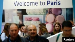 Visitors browse the exhibition stand of French capital Paris at the International Tourism Trade Fair (ITB) in in Berlin, Germany, March 9, 2016.