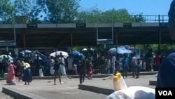 Commuters stranded at Bulawayo's local bus and commuter omnibus terminus. (Photo: Taurai Shava)