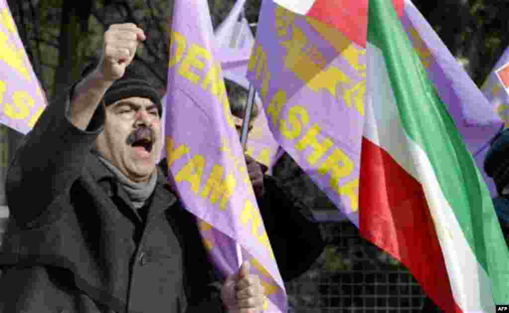 A man shouts slogans as some thirty activists of the Iranian Resistance Council demonstrate in front of the Iranian embassy in Berlin, Germany, Tuesday, Feb. 15, 2011. (AP Photo/Michael Sohn)