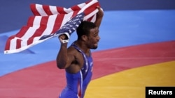 Jordan Burroughs of U.S. celebrates after defeating Iran's Sadegh Saeed Goudarzi in the final of the men's 74Kg freestyle wrestling at the ExCel venue during the London 2012 Olympic Games, August 10, 2012.
