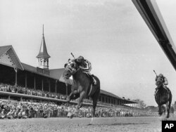 FILE - Secretariat, with jockey Ron Turcotte up, passes the twin spires of Churchill Downs during the running of the 99th Kentucky Derby in Louisville, Ky. on May 5, 1973. (AP Photo)