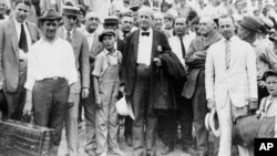 William Jennings Bryan, center, arrives at Dayton, Tenn., in 1925. Bryan, a fundamentalist, is associate prosecutor in the trial of the State of Tennessee vs. John Thomas Scopes, a public school teacher who violated the law when he taught Darwinism.