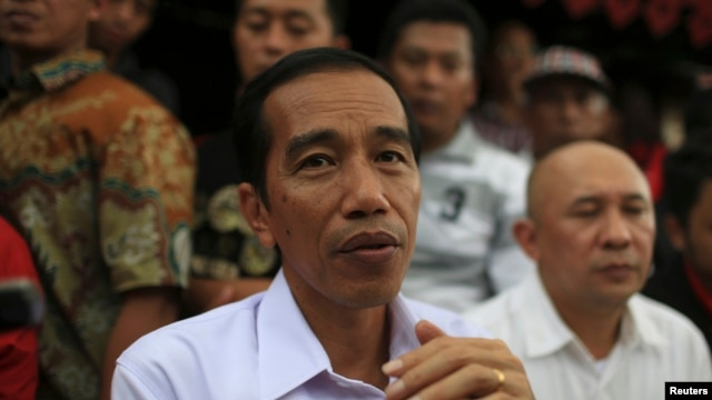 FILE - Jakarta governor and presidential candidate Joko Widodo looks on during PDIP party campaign in Jakarta, March 16, 2014.