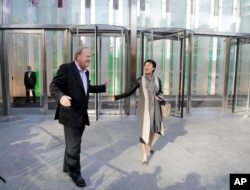 Charles Townsend, CEO of Conde Nast, arrives at One World Trade Center with Patricia Röckenwagner, senior vice president of Corporate Branding and Communications, Nov. 3, 2014, in New York.
