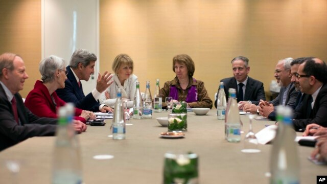 n this Nov. 9, 2013 photo, U.S. Secretary of State John Kerry, third left, meets with EU High Representative for Foreign Affairs, Catherine Ashton, center, and Iranian Foreign Minister Mohammad Javad Zarif, third right,  at the Iran Nuclear talks in Genev