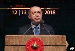 Turkey's President Recep Tayyip Erdogan delivers a speech during a defense industry meeting event in Ankara, Turkey, Dec. 12, 2018.