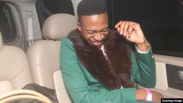 Abebayo Oke-Lawal has attracted the fashion world with designs like this green fur-collared coat he wore recently. Adebayo Oke-Lawal directs Orange Culture from his Lagos studio. (Photo Courtesy Orange Culture)