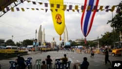 Anti-government protesters wait for the next course of action from their leaders, near the Democracy Monument, in Bangkok, Thailand, Friday, Dec. 6, 2013. The truce between Thailand's political rivals held in Bangkok on Friday amid more ceremonies in hono