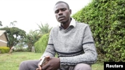 Independent John Paul Mwirigi, who is now a member of the Kenyan parliament, sits outside the tallying center in Maua Girls High School, in Maua, Kenya, Aug. 9, 2017. Mwirigi won the election wearing just one sweater, having no car and not handing out any printed posters.