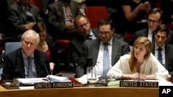 FILE - United Kingdom U.N. Ambassador Mark Lyall Grant, left, listens as Samantha Power, the U.S. ambassador to the United Nations, speaks during a meeting of the U.N. Security Council Monday, Dec. 22, 2014, at the United Nations headquarters.