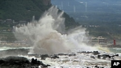 High waves crash on the eastern coast of Jeju Island, South Korea, as Typhoon Bolaven approaches the Korean Peninsula, Aug. 27, 2012.