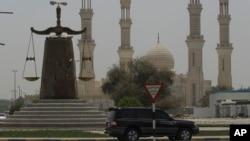 A justice symbol monument is seen in front of a mosque in Ras al Khaimah, United Arab Emirates in this file photo. On July 2, 2013, a UAE court convicted 69 Islamists in connection with a plot to overthrow the government.