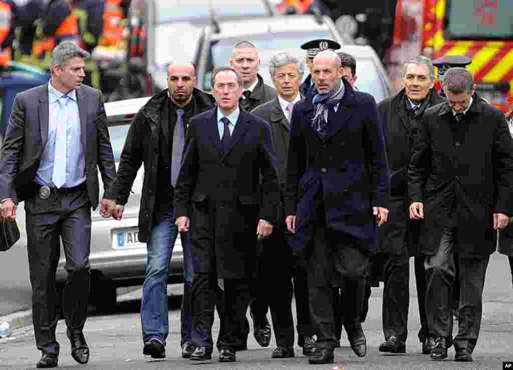 """France's French Interior minister Claude Gueant (3rdL) arrives to speak to journalists in Toulouse, southwestern France. Self-professed Al-Qaeda militant Mohamed Merah died during a police assault on his besieged flat. """"Mohamed Merah jumped from the windo"""