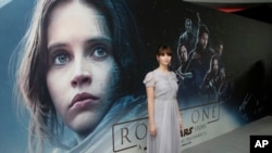 Actress Felicity Jones, who plays Jyn Erso, poses for photographers at the Rogue One: A Star Wars Story fan screening in London, Dec. 13, 2016. At the box office, the film was a top performer for 2016..