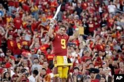 FILE - Southern California quarterback Kedon Slovis (9) directs the school's band after a 52-35 win over UCLA in an NCAA college football game, Saturday, Nov. 23, 2019, in Los Angeles. (AP Photo/Marcio Jose Sanchez)