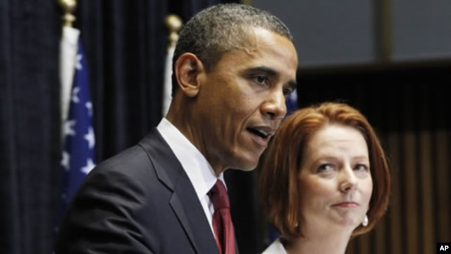 U.S. President Barack Obama and Australian Prime Minister Julia Gillard speak at a joint news conference at Parliament House in Canberra, Australia, November 16, 2011.