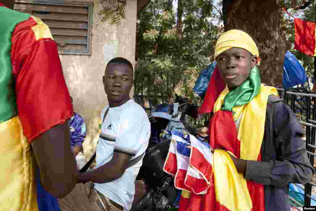 Young men sell homemade French and Malian flags at a junction in downtown Bamako, Mali.
