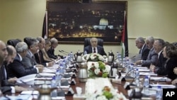 Palestinian Prime Minister Salam Fayyad speaks to his cabinet members after a meeting in the West Bank city of Ramallah, February 14, 2011