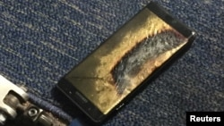 FILE - A burned Samsung Note 7 smartphone belonging to Brian Green is pictured in this undated handout photo obtained by Reuters.