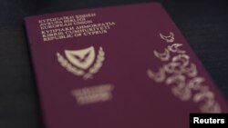 A photo illustration of a Cypriot passport, October 12, 2019.