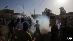 Protes anti-pemerintah di Baghdad, Irak meledak menjadi kekerasan Jumat sore (20/5).