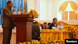Cambodian People's Party Honorary President and President of the National Assembly of Cambodia Heng Samrin (L) speaks as Vice President of the CPP and Cambodia's Prime Minister Hun Sen looks on at the Extraordinary General Assembly of Cambodian People's Party, in central Phnom Penh January 30, 2015.