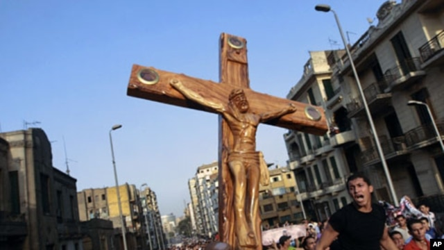 Angry Egyptian Christians protest outside St. Mark's Cathedral against the military ruling council, Oct. 10, 2011, a day after at least 24 people were killed in central Cairo