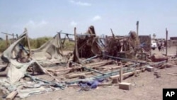 Foto dari rekaman video tanggal 28 September 2015, menunjukkan lokasi perumahan yang rusak di desa al-Wahga, sebuah desa di Yaman. Warga setempat sedang melakukan pesta pernikahan ketika serangan udara koalisi pimpinan Saudi menghantam lokasi tersebut.