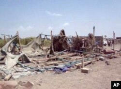This still image taken from video shot Sept. 28, 2015, shows destruction to buildings after an airstrike hit a wedding party in al-Wahga, a village near the strategic Strait of Bab al-Mandab, Yemen.